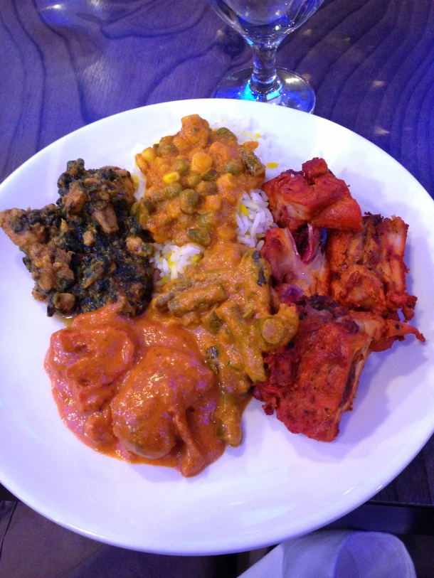 Clockwise starting with Tandoori chicken, aloo beans, butter chicken, sagg chicken, and vegetarian curry