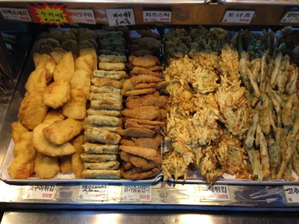 Lots of fried sweet potatoes, kimbap, and vegetables (left to right)