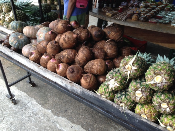 Left to right:  pumpkins, purple sweet potatoes, and pineapples