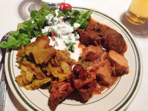 Clockwise: green salad, lamb, chicken, vegetable pakora, and eggplant